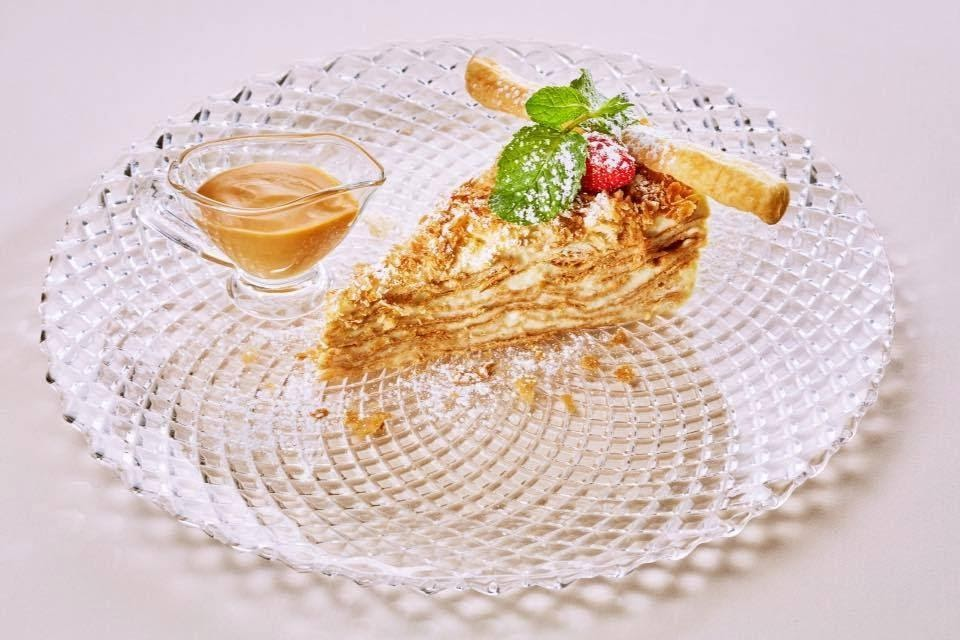 A cake Napoleon is a branded dessert of the Valentino restaurant.